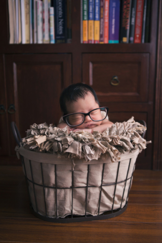 Baby Photography featuring newborn in prop
