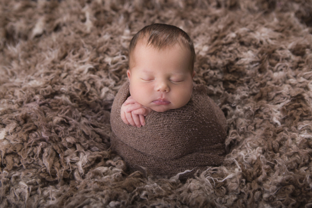 Newborn baby boy portrait