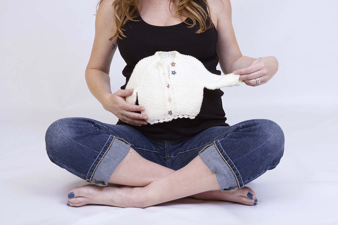 In studio Photography of Expecting Mom