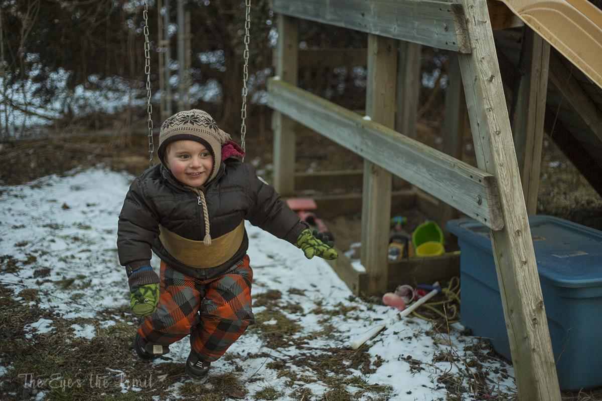 Boy having fun on swing