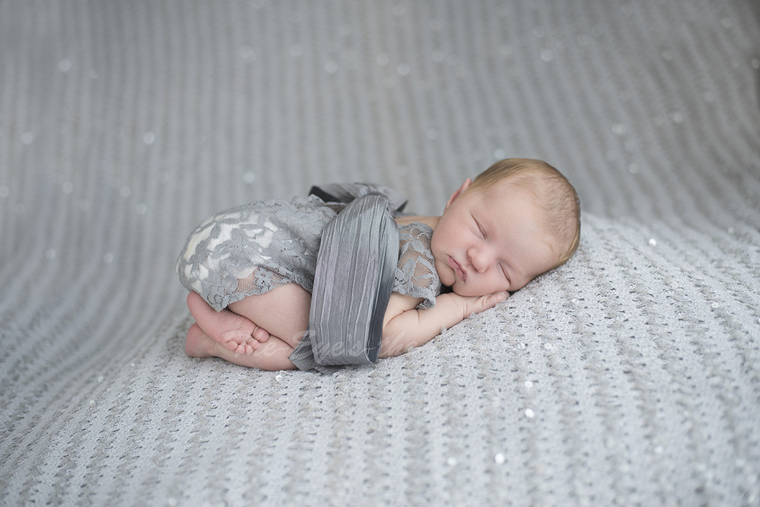 Newborn baby sliver glitter baby girl in grey outfit