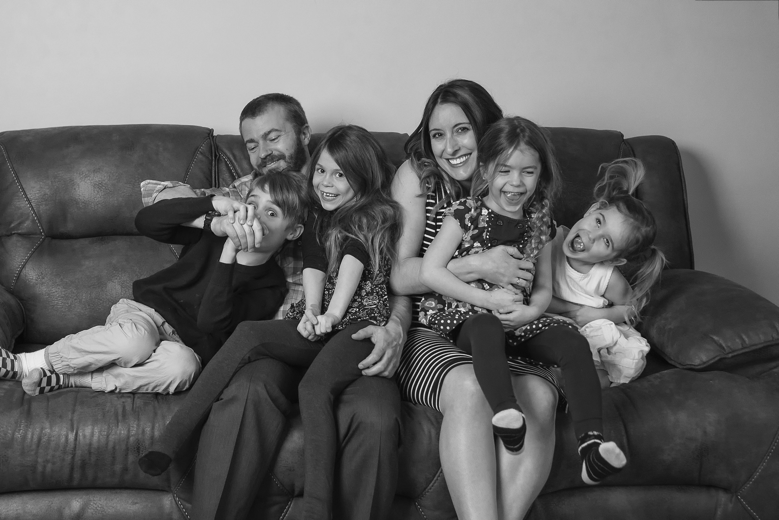 Waterloo North Family having fun on their couch in a lifestyle image