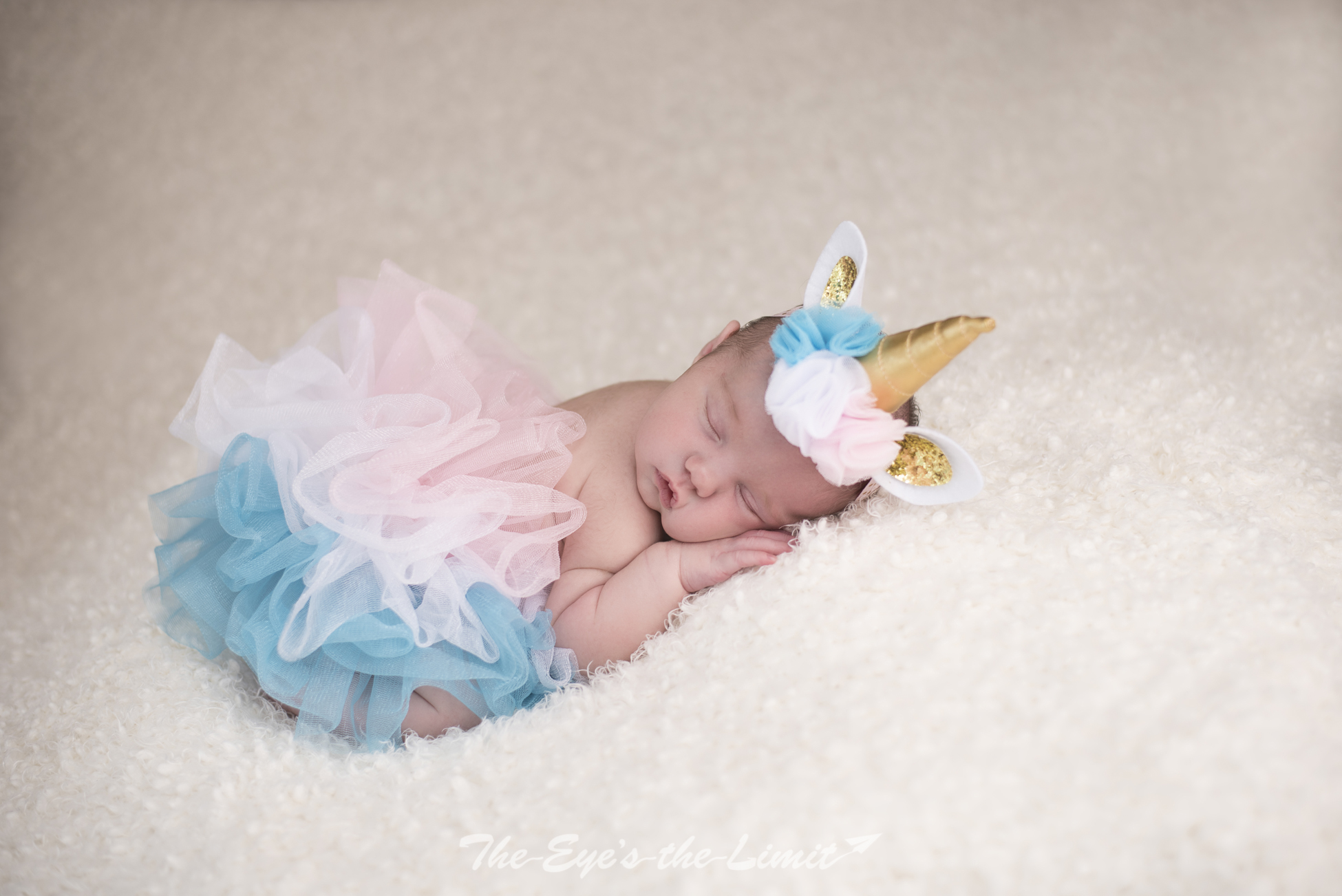 Newborn in unicorn outfit